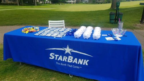 Star Bank table full of Star Bank swag