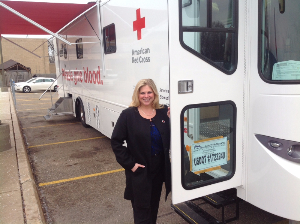 Middle aged female American Red Cross volunteer and blood drive coordinator