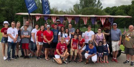 Maple Lake and Annandale team plus their families at the fourth of July parade.