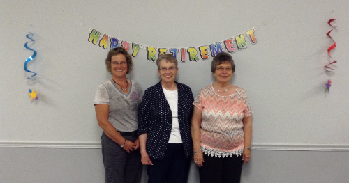 3 elderly ladies celebrating at a retirement party
