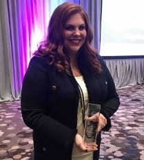 Katie Wahlquist receives the 2019 Top Women in Finance award.