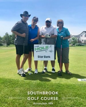 Dale and Denise at the Star Bank sponsored hole at Southbrook golf course.